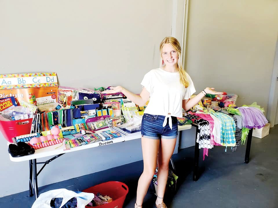 Billie-Kate Pope stands with the school supplies she raised during a recent back to school drive.