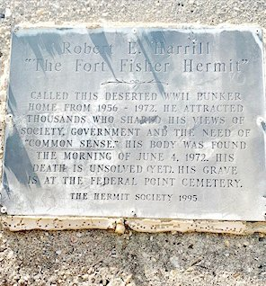 This plaque is displayed on the World War II bunker where the Fort Fisher Hermit, Robert Harrill, lived for 17 years.