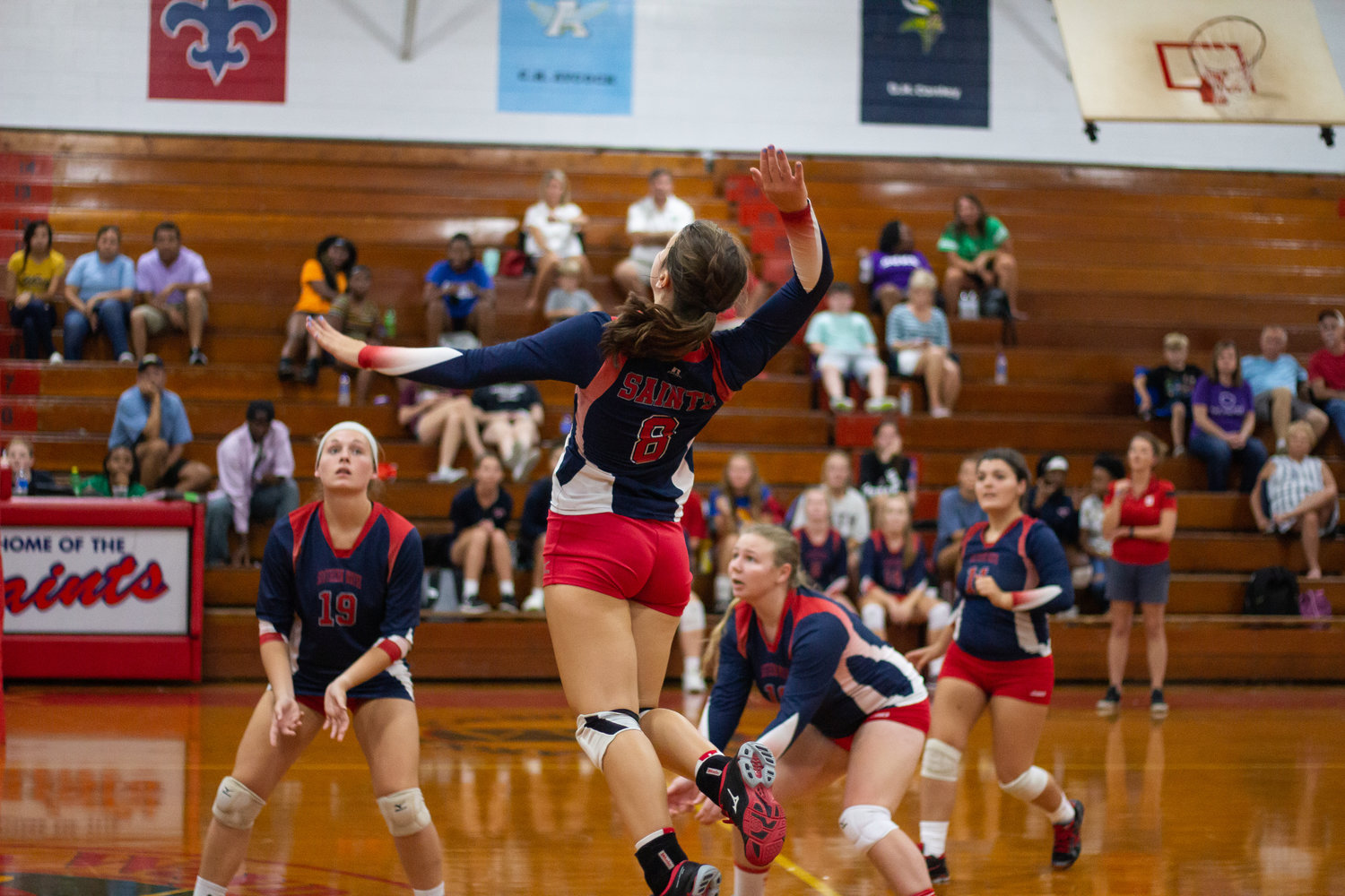 Senior Morgan Kennedy rises up to send the ball over the net in attempt to record a kill in the Saints' match against North Lenoir.