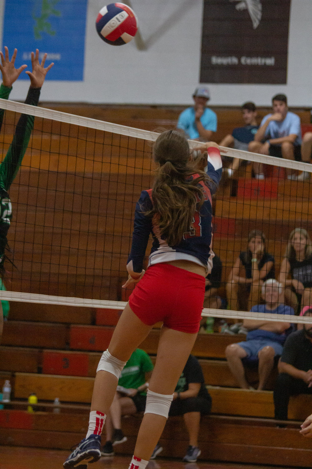 Senior Daylan Wiggs goes up for a kill in the Saints' 3-0 loss to North Lenoir.