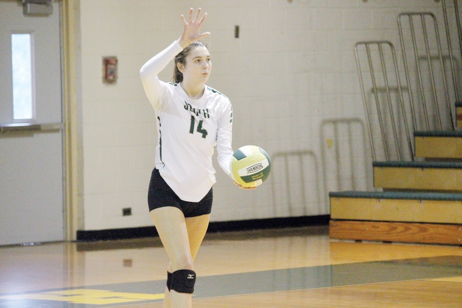 South Johnston's Jenna Brown sets to serve in the Trojans' 3-1 victory over Midway on Tuesday.