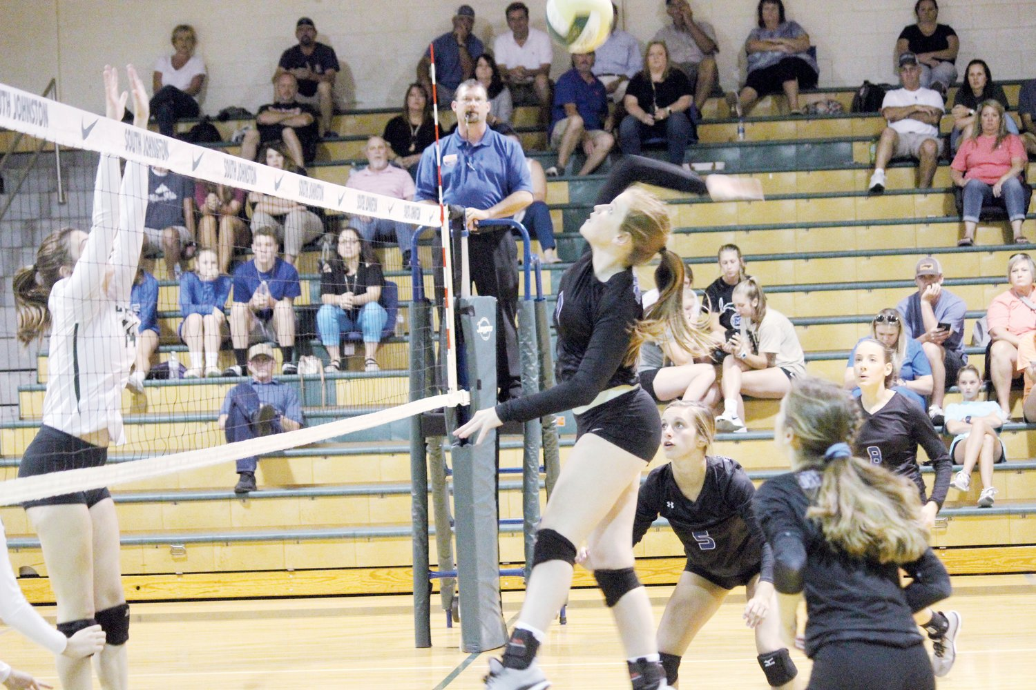 Allison Bellflowers rises for one of her eight kills. The Midway junior's performance was one of the bright spots in the Raiders' loss at South Johnston on Tuesday.