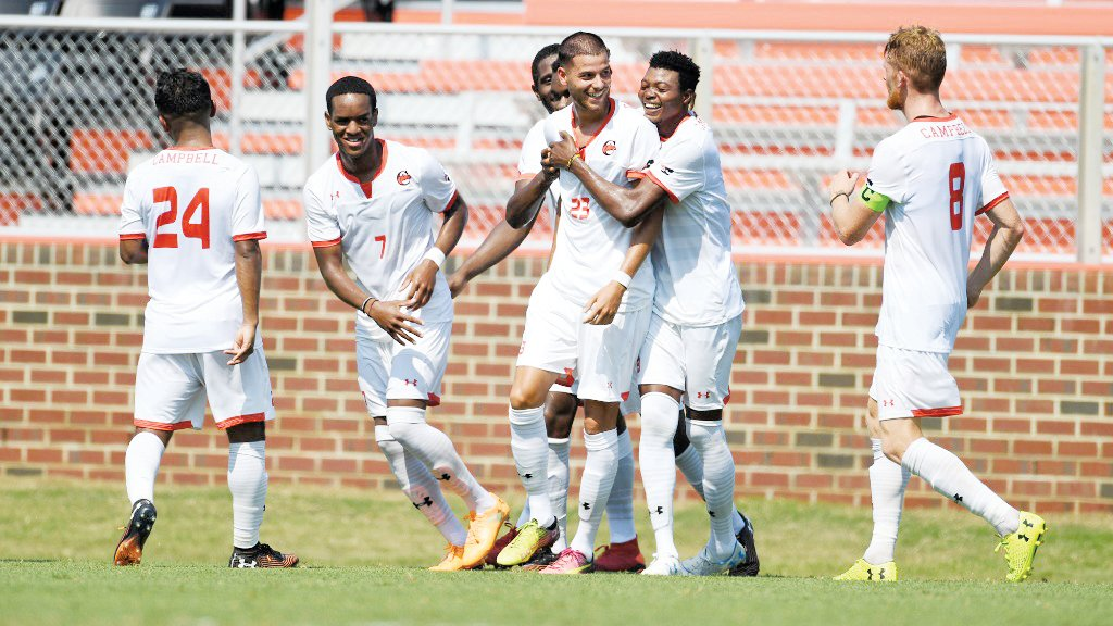 Campbell players celebrate with Eren Elbustu (No. 23) after he scored one of his two goals in the Camels' 3-0 win at home over George Mason on Sunday.