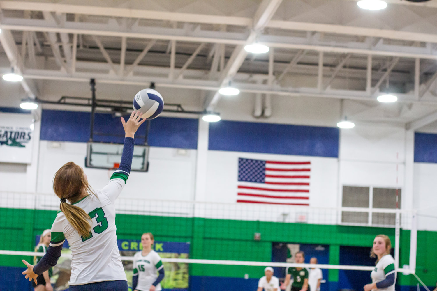 Spring Creek's Alissa Price serves in the third set against North Duplin.