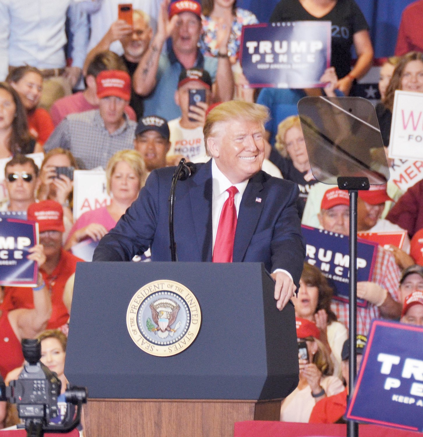 President Donald Trump smiles at the crowd as he listens to the applause generated by some of his remarks during a Keep America Great Rally in Fayetteville Monday night.