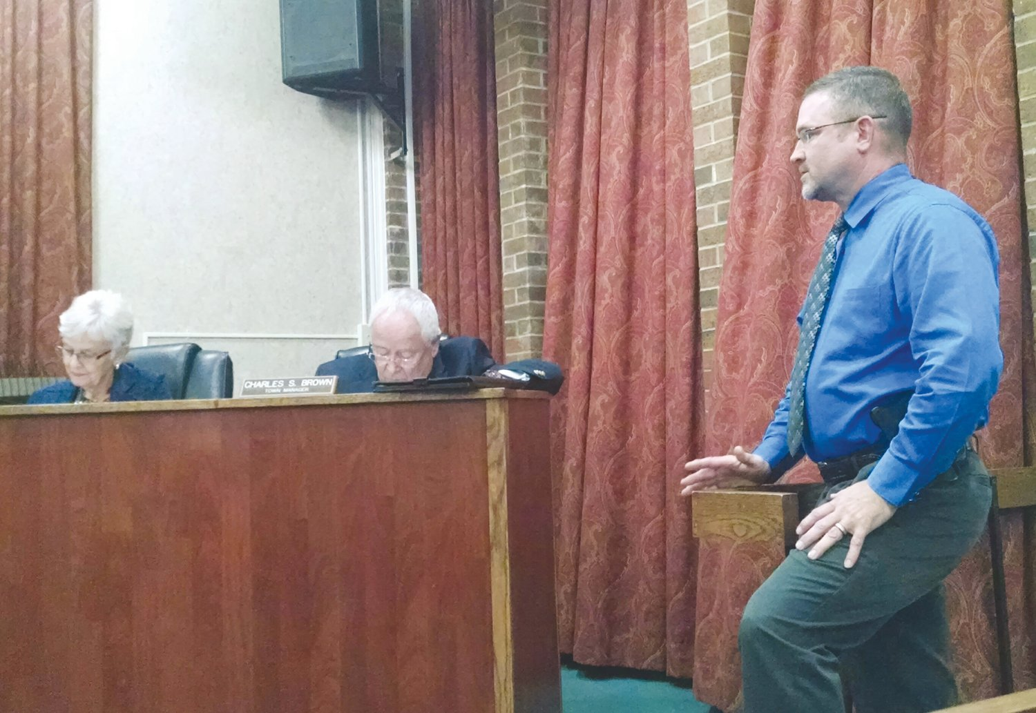 Mount Olive Police Chief Tommy Brown addressed members of the town board last week on details of switching the 40-caliber handguns his officers currently carry with 9-mm firearms.