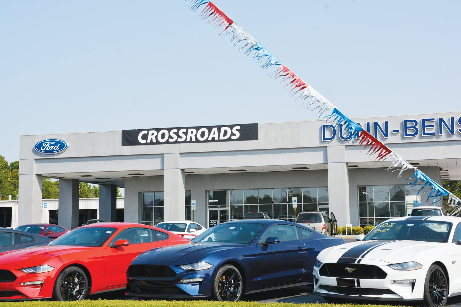 Dunn-Benson Ford has been purchased by Crossroads Ford in Cary. A new banner was up on the Dunn building Thursday.