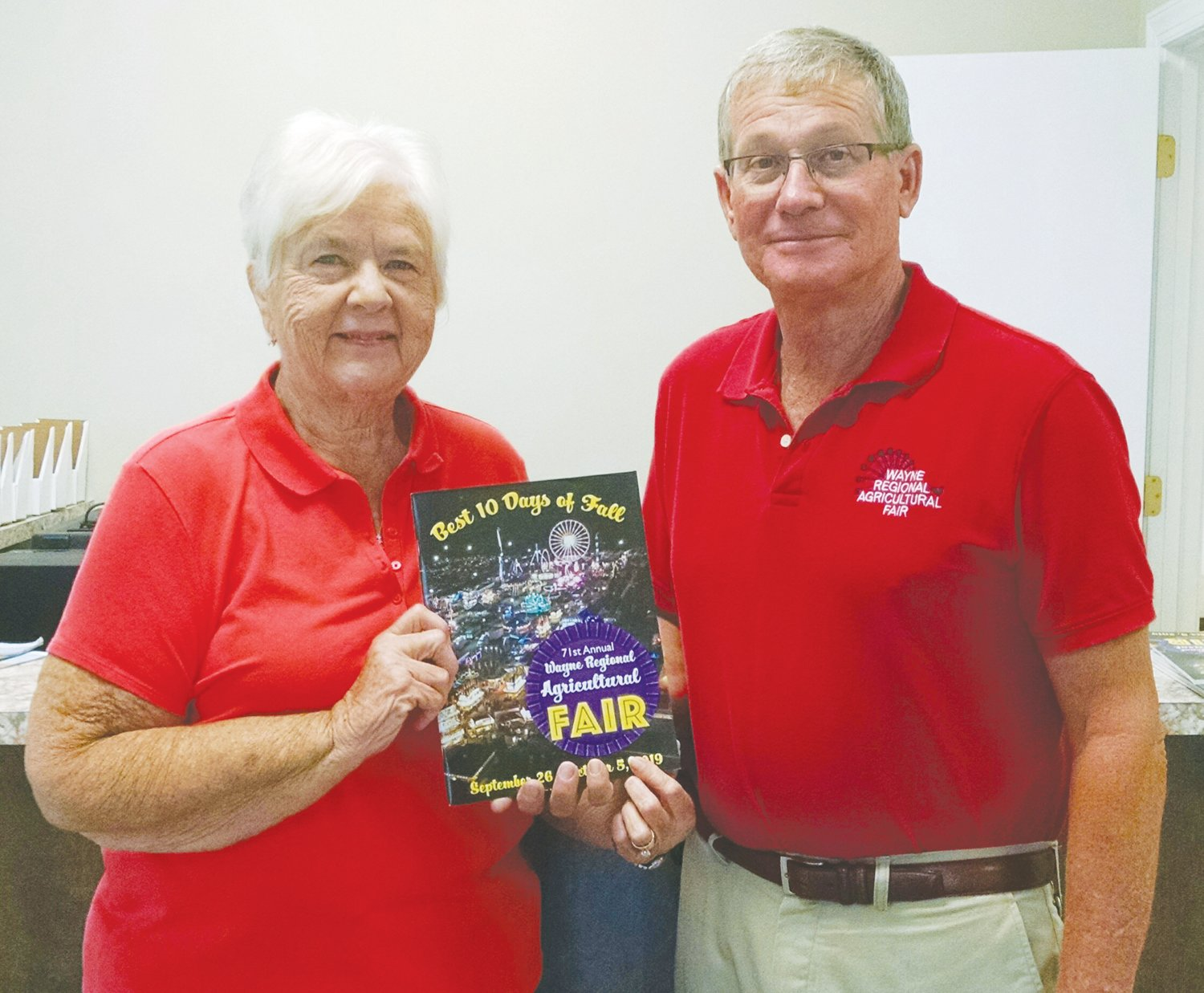 "The catalogue detailing information of the 71st annual Wayne County Regional Fair is now available. Shown here are office manager Edythe Blanton and fair manager Eddie Pitzer. The fair is set this year for Sept. 25-Oct. 6, and is being promoted as ""The best 10 days of fall."""