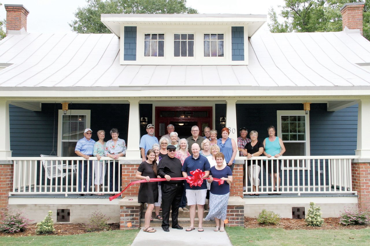 The Coats family celebrated its renovation of the Founders House in Coats with a recent ribbon-cutting.