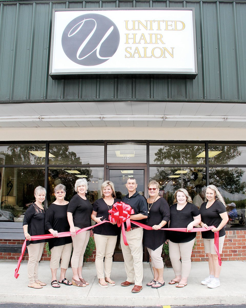 United Hair Salon reopened under new ownership in Coats. The new owners celebrated its grand reopening with a ribbon-cutting.