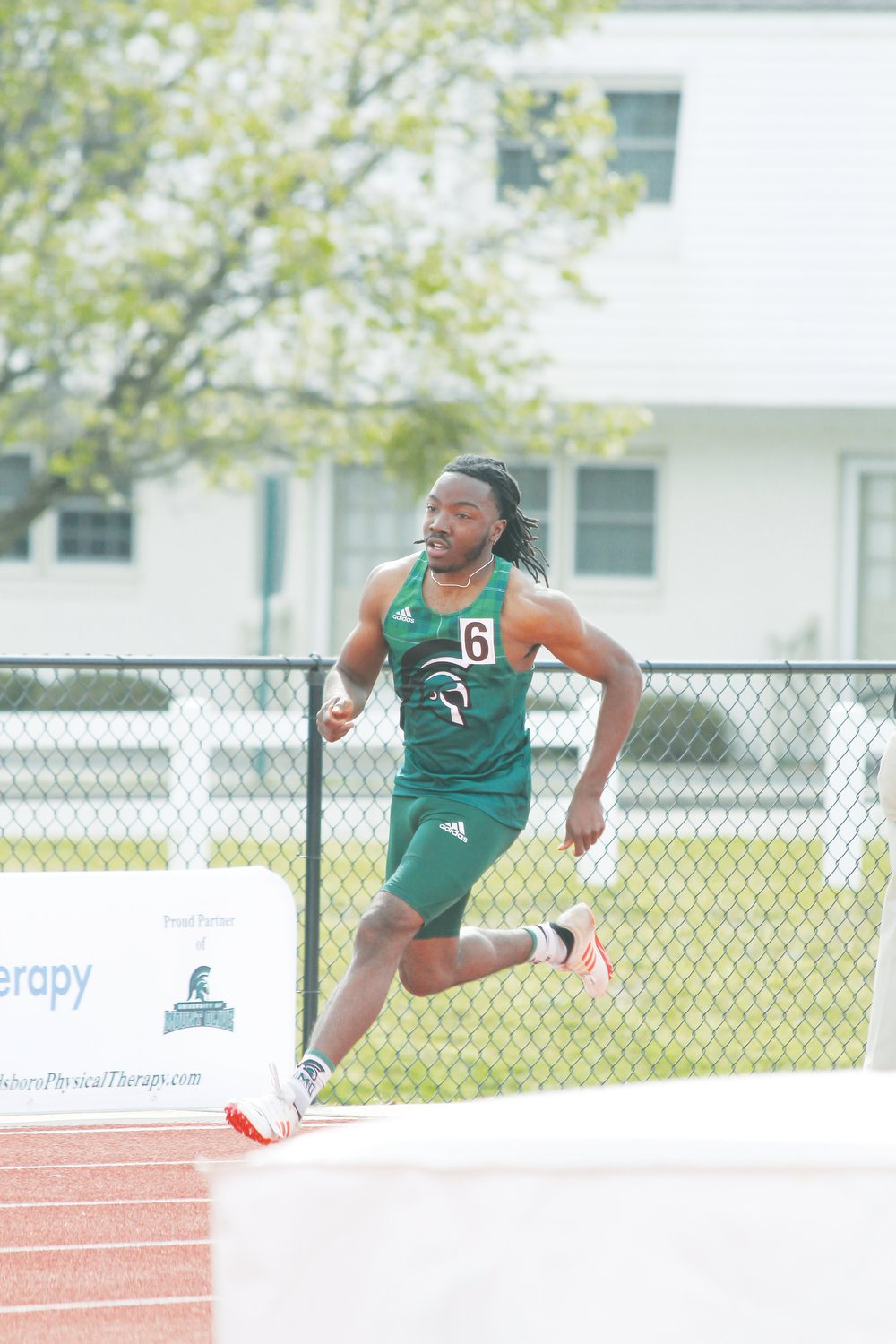 Montrell Perry competes in the 100-meter dash at an outdoor meet last season.