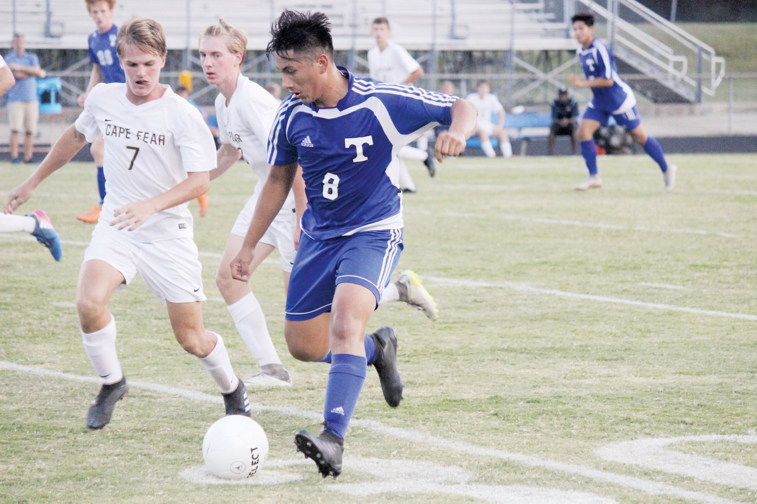 Triton's Kevin Paz dribbles up the pitch in an earlier win against Cape Fear. Paz scored two goals in Monday's 4-1 win on the road against rival Harnett Central.