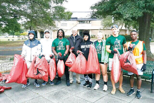University of Mount Olive Athletic Director Jeff Eisen is surrounded here by a group of UMO athletes who participated in last weekend's annual townwide Litter Sweep. From left are: Bailey Parks, Franco Cuccrello, Dorian Tolbert, Eisen, Cienrra Daniel, Candy Lockett, Paul Espag and J.d. Faison. Nearly 100 students participated.