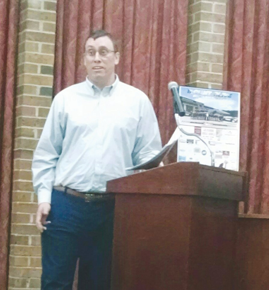 "North Carolina Department of Transportation District Engineer Sam Lawhorn explains DOT's proposed ""Band-Aid"" fix to a Bert Martin Road safety issue to a group of concerned residents. Lawhorn was at a recent meeting of the town board."