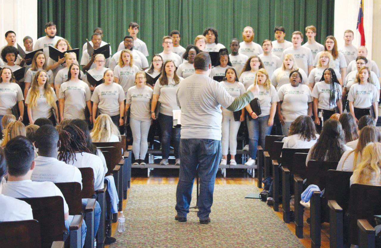 University of Mount Olive Choir Director Jonathan Saeger directs the UMO Choir at the All-Star Festival.