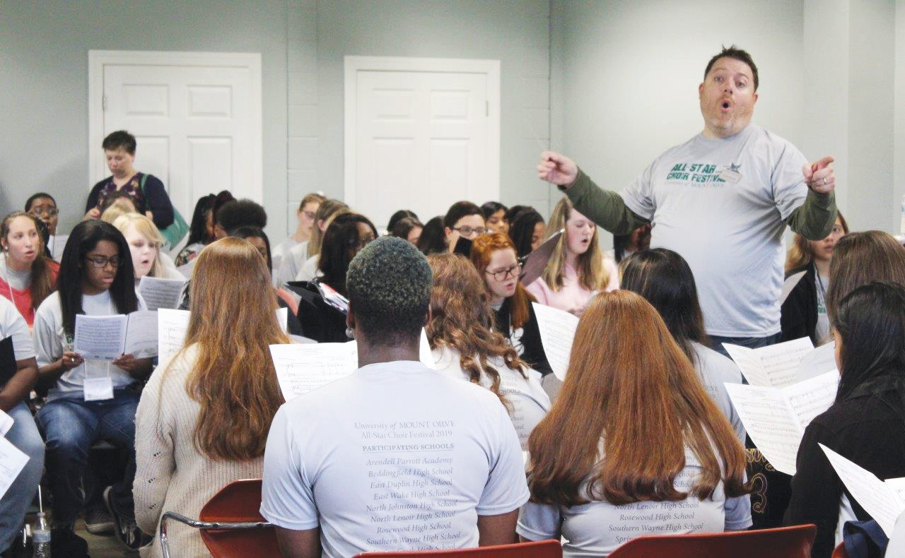 UMO Choir Director Jonathan Saeger directs high school students during the All-Star Festival.