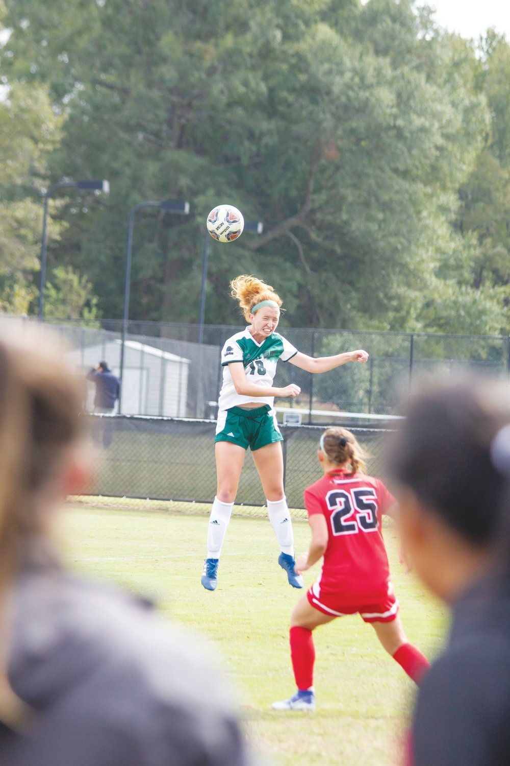 Erica Boswell heads the ball in the air against the Crusaders of North Greenville.