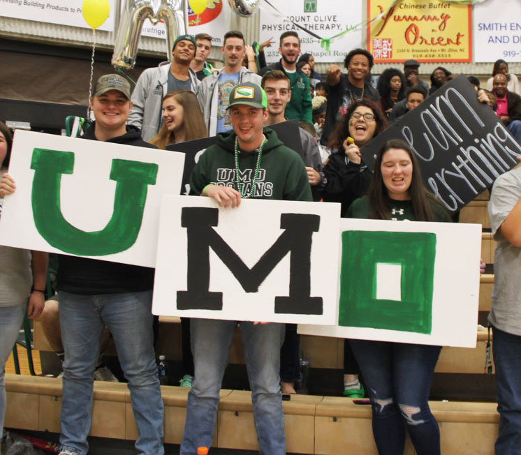 The UMO Student section holds up signs during Pickle Classic.