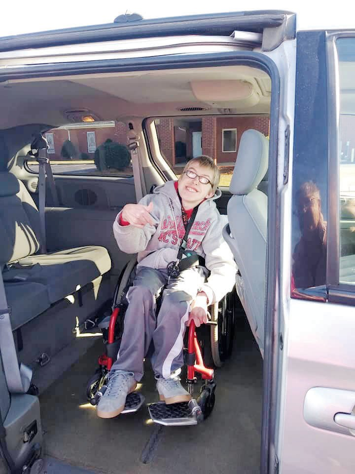 Twenty-four-year old Jacob Wade is pictured in the 2007 Town and Country handicap accessible mini van he was awarded by Hodges Chapel Church.