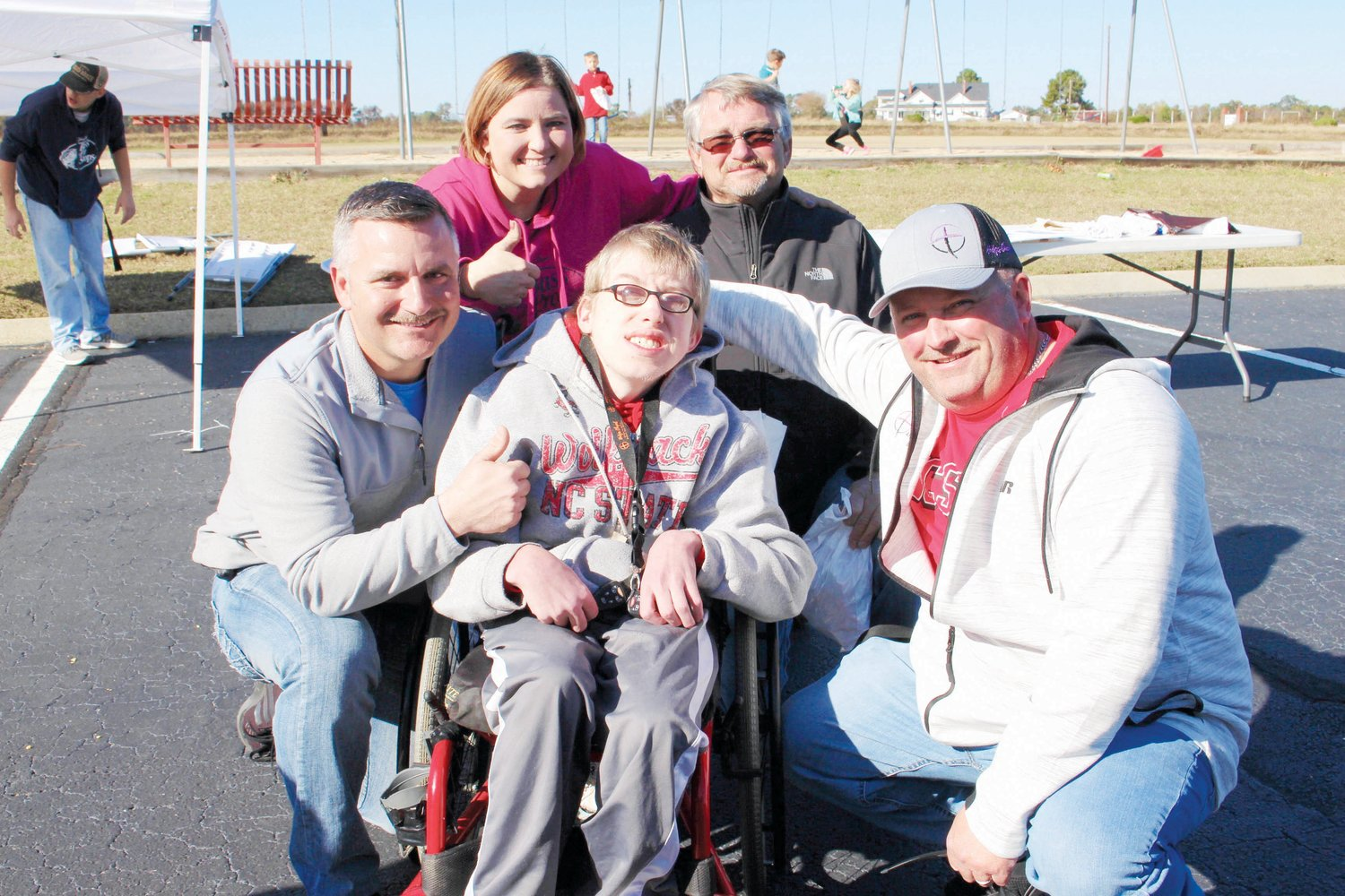 Jacob Wade, center, was the recipient of handicap accessible mini van during the 4EverFriends event at Hodges Chapel Church. He is pictured with, front left, Ashley Anderson and, right, Pastor Michael Preddy, and, in back, Tangie Barefoot and Jerry Johnson, owner of Johnson's Transmission and Auto Service that fixed the van. Not pictured is Max Miller of Miller's Paints & Parts, who donated the parts.
