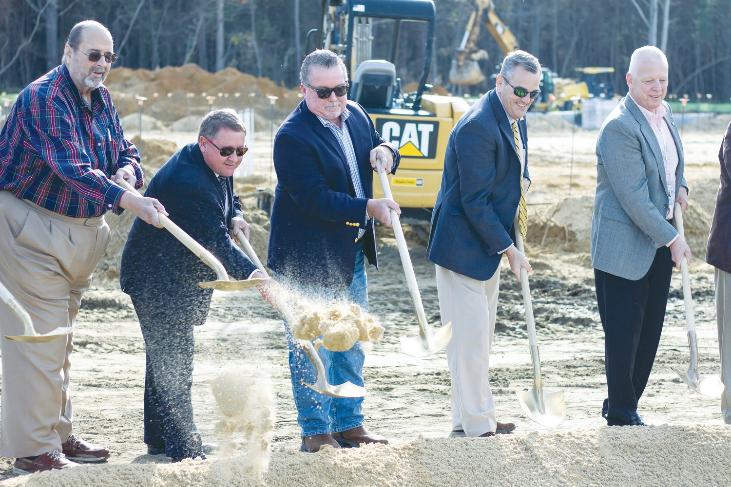 Members of the Wayne County Board of Education shovel dirt at the site of the new Southern Wayne High School gym at a recent ground-breaking ceremony. From left, Richard Pridgen, Ven Faulk, Don West, Wayne County Public Schools Superintendent Michael Dunsmore and Wayne County Manager Craig Honeycutt break ground.
