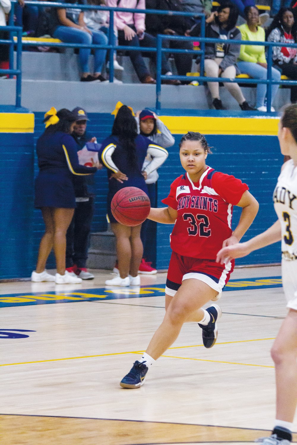 Alissa Meadows drives after a steal in the second quarter against Goldsboro. Meadows finished with 16 points on the night.