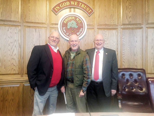Commissioners Craig Honeycutt, Bob Smith and Alan Coats, who is new to the board this year, pose for a photo prior to the start of the meeting.