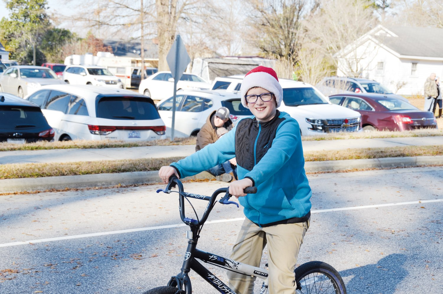 Mark Harrell enjoys the Angier Christmas parade from his bicycle Saturday morning. A large crowd enjoyed this year's event.