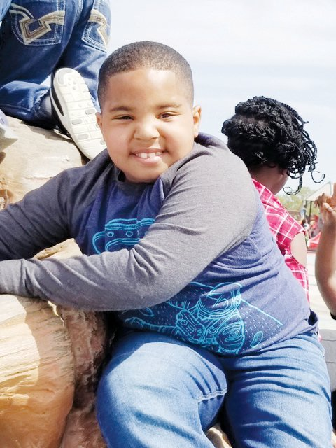 Ethan Nicholas, 8, is a third-grader at Coats Elementary School who suffers from a rare chromosome disorder. His mother, Erica Gonzalez, in 2017 created a foundation in his honor to help meet the needs of Exceptional Children students in Harnett County.