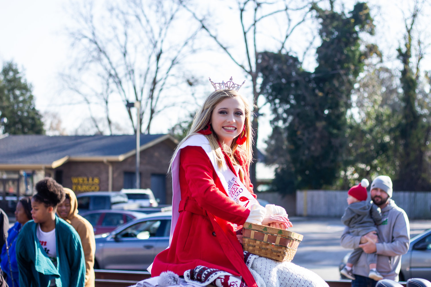 Miss Outstanding Teen Hayden Pearson rides and passes out candy during the Christmas parade.
