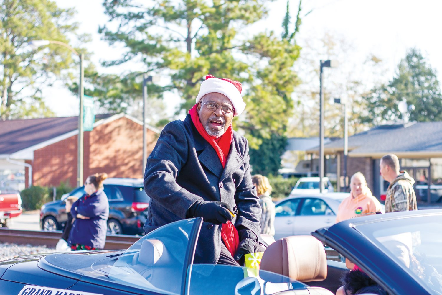 Parade Grand Marshal Al Southerland talks to on-lookers during the Christmas parade.