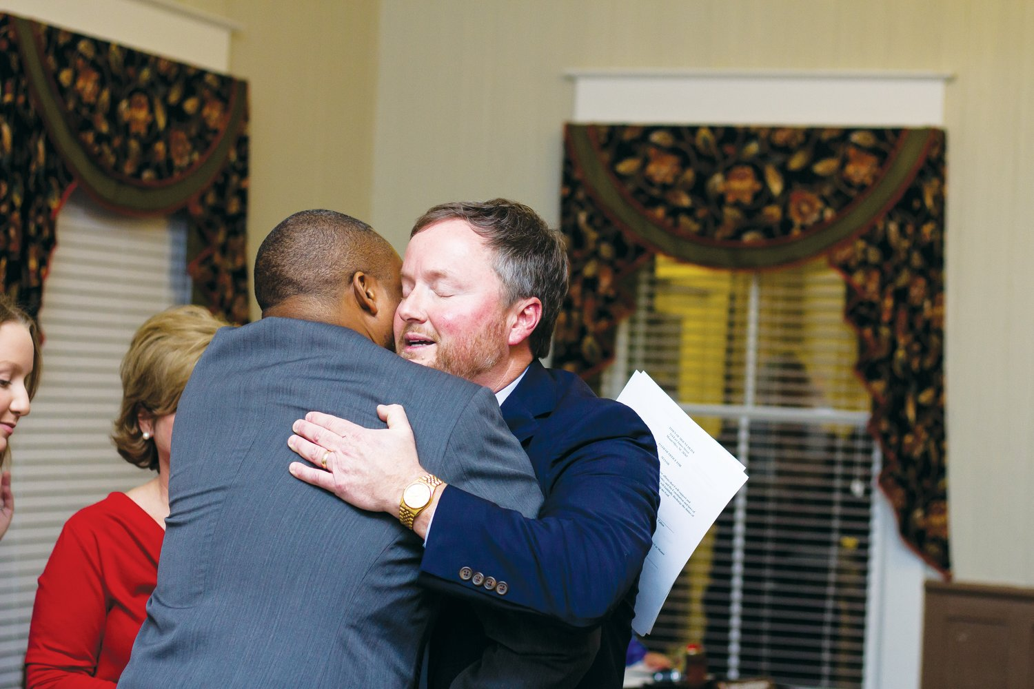 Mayor Kenny Talton hugs friend and Sen. Don Davis after being sworn in as the new mayor of Mount Olive.