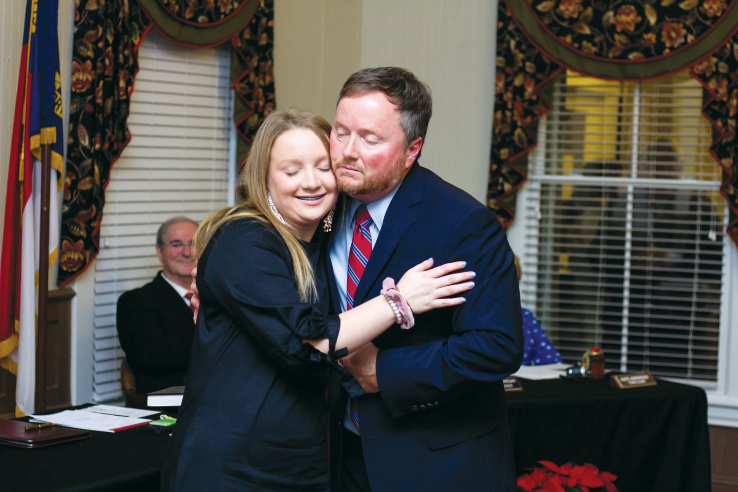 Kenny Talton hugs daughter, Mary Emma Talton, after taking the oath of office as Mount Olive's new mayor.