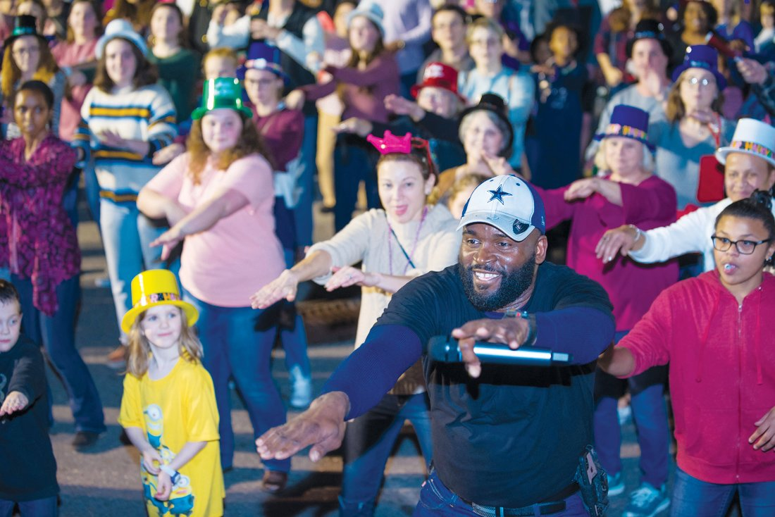 DJ (and Mt. Olive employee) L.J. Manley leads the New Year's Eve crowd in line dancing..