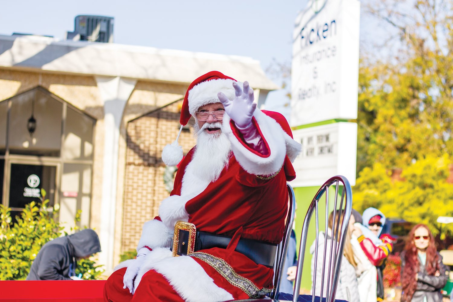 Santa Claus waves to the crowd from his ride in the Mount Olive Christmas Parade Saturday.