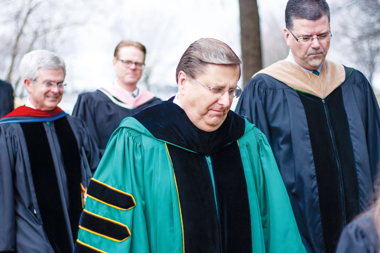 UMO hosts graduation. .Dr. David Poole leads the faculty outside to create a tunnel for the graduates to walk through at a commencement ceremony for the University of Mount Olive.