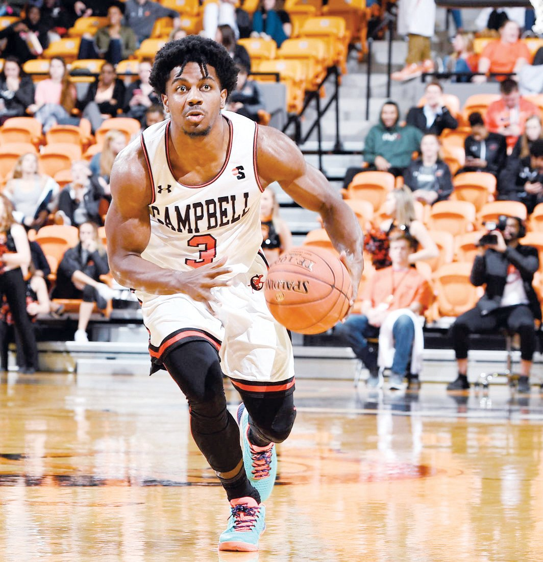 Chris Clemons dribbles up the court. The Campbell graduate led the nation in scoring this season at 30.1 points per game and was named the Big South Player of the Year. He's third on the all-time NCAA scoring list (3,225 points), and is currently a member of the Houston Rockets.