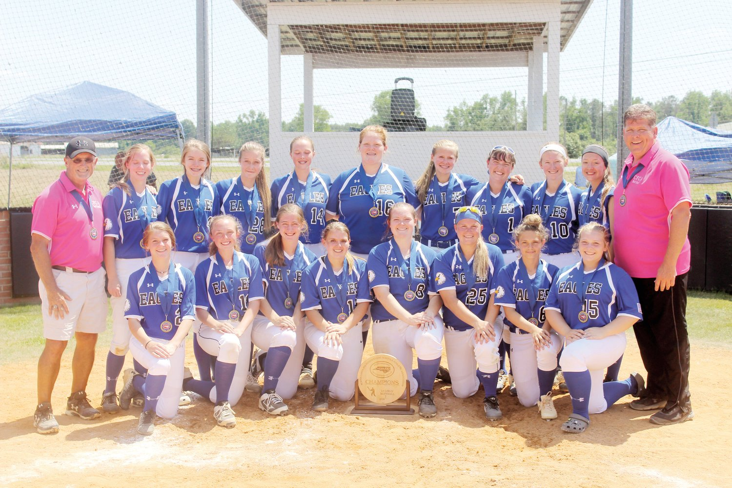 Cape Fear Christian Academy poses for a team shot after winning the 2019 NCISAA 1A Softball Champions. Kneeling from left are Gabbi Chiodo, Anslee McLamb, Meghan Taylor, Jada Horne, Kristen Bass, Paige Jeffries, Harmony Horne and McKenzie Burris. Standing from left are Coach Sterling Holmes, Claire Parker, Leah Brannon, Shelby Hodges, Rebekah Ennis, Aubree Bass, Averi Williams, Natalia Brocious, Rhyleigh Horne, Trinity Olive and assistant coach Craig Autry.