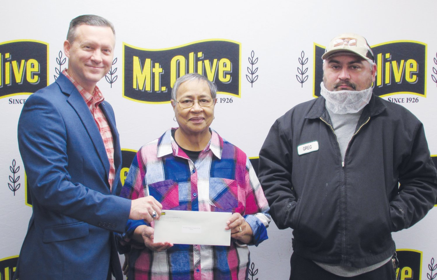 Mt. Olive Pickle Company's Employees Community Fund Chairman Patrick Muston, left, presents a check for $2,500 to Lauren Holliday, manager of WAGES Nutrition Center. Also pictured is Mt. Olive Pickle Employee Community Fund member Greg Martinez. The Employees Community Fund contributed a total of $149,263 to 52 organizations in 2019.