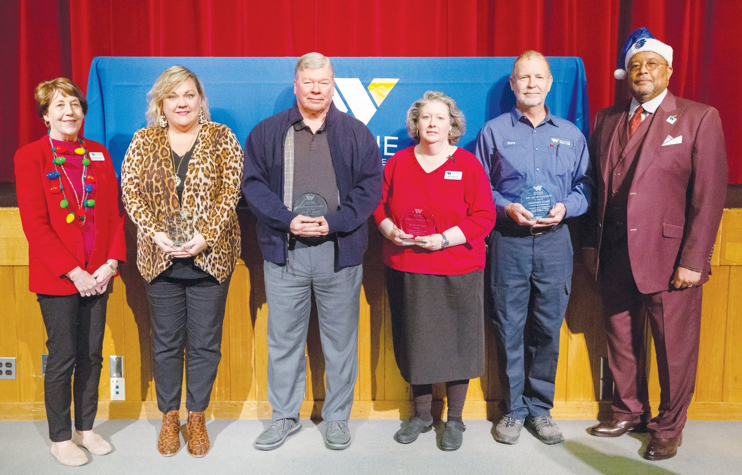 Foundation of Wayne Community College Executive Director Adrienne Northington, far left, and WCC President Thomas A. Walker Jr., far right, stand with the top employees of 2019 recently honored at the school. From left, they are Northington, Administrative Assistant Michelle Dixon - Professional Support Staff of the Year, Instructor Larry Stroud - Adjunct Faculty of the Year, Institutional Effectiveness Coordinator Becky Mulligan - Professional Employee of the Year, Maintenance Technician Steve Underwood - Operational and Maintenance Staff Employee of the Year, and Walker.