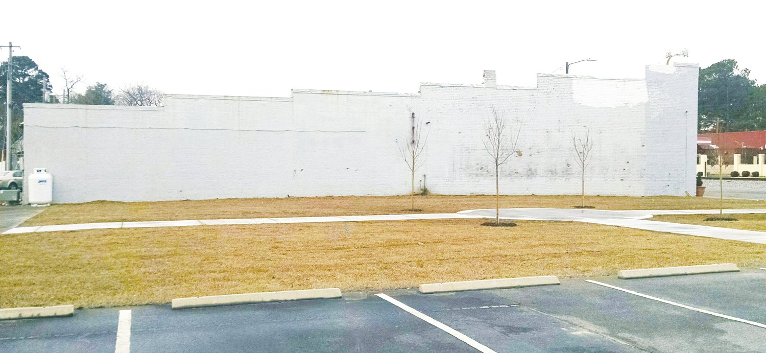 This recently-cleared lot, where two buildings were demolished, has been landscaped as a small park by Southern Bank, and there are discussions with the Wayne County Arts Council about a mural on the blank wall next to it. It is all part of continued beautification efforts in the downtown area.