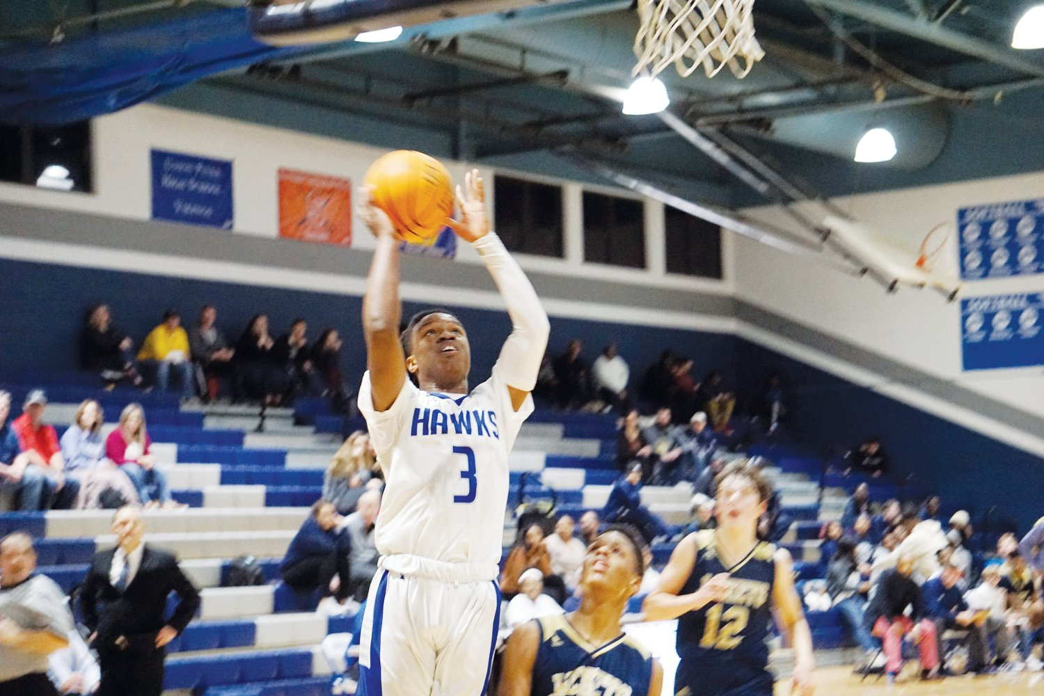 Travion Sanders gets up for a tough bucket during Friday night's game. The senior led Triton with 17 points, 13 of which fueled the Hawks' comeback in the fourth quarter.