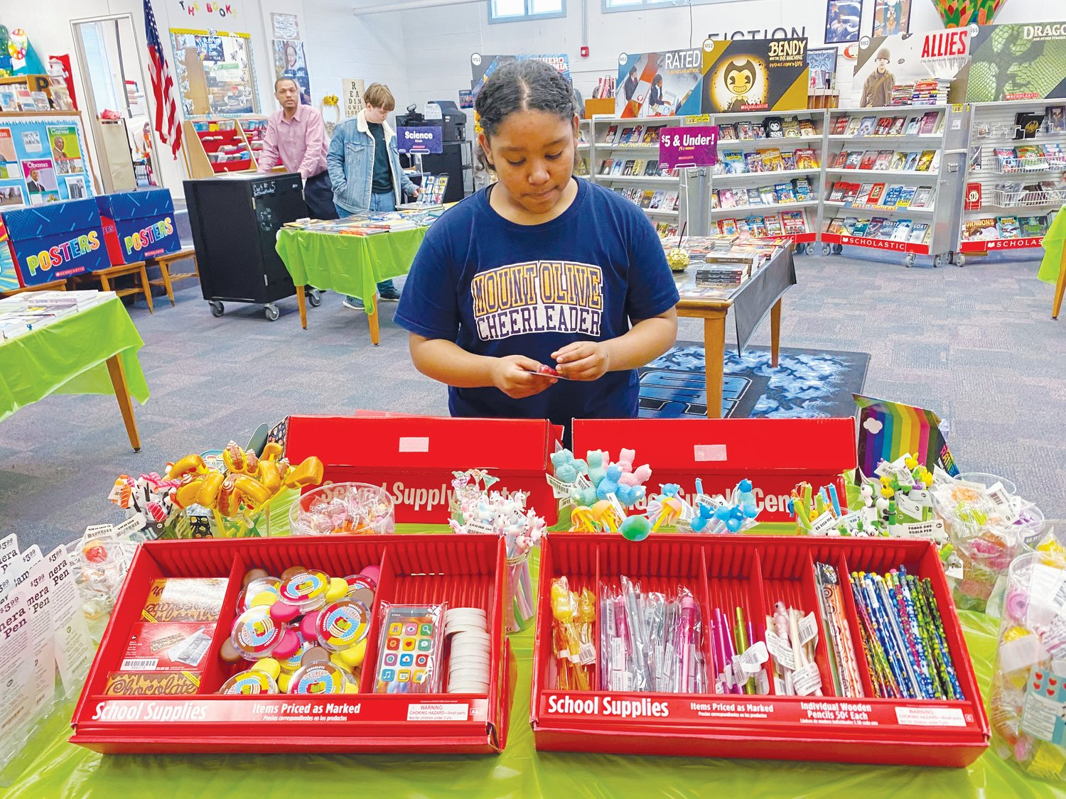 Kids make selections at local book fair.Sixth-grader Shaily Quim-King makes a careful selection at the novelty section during last week's book fair at Mount Olive Middle School.