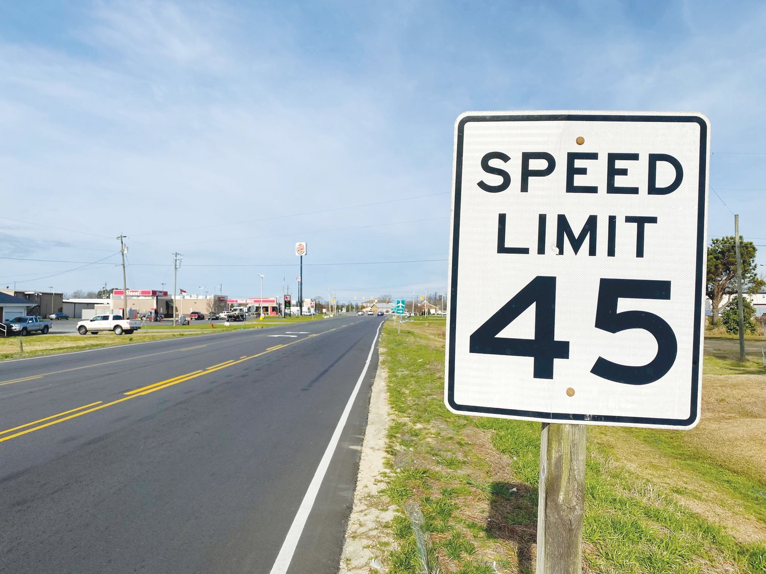 A sign on N.C. Highway 55 tells drivers the speed limit is 45 mph. The town of Mount Olive is asking the DOT to conduct a feasibility study on lowering the speed limit from 45 to 35 mph between the Mount Olive Animal Hospital, just east of Breazeale Avenue, and Walmart.