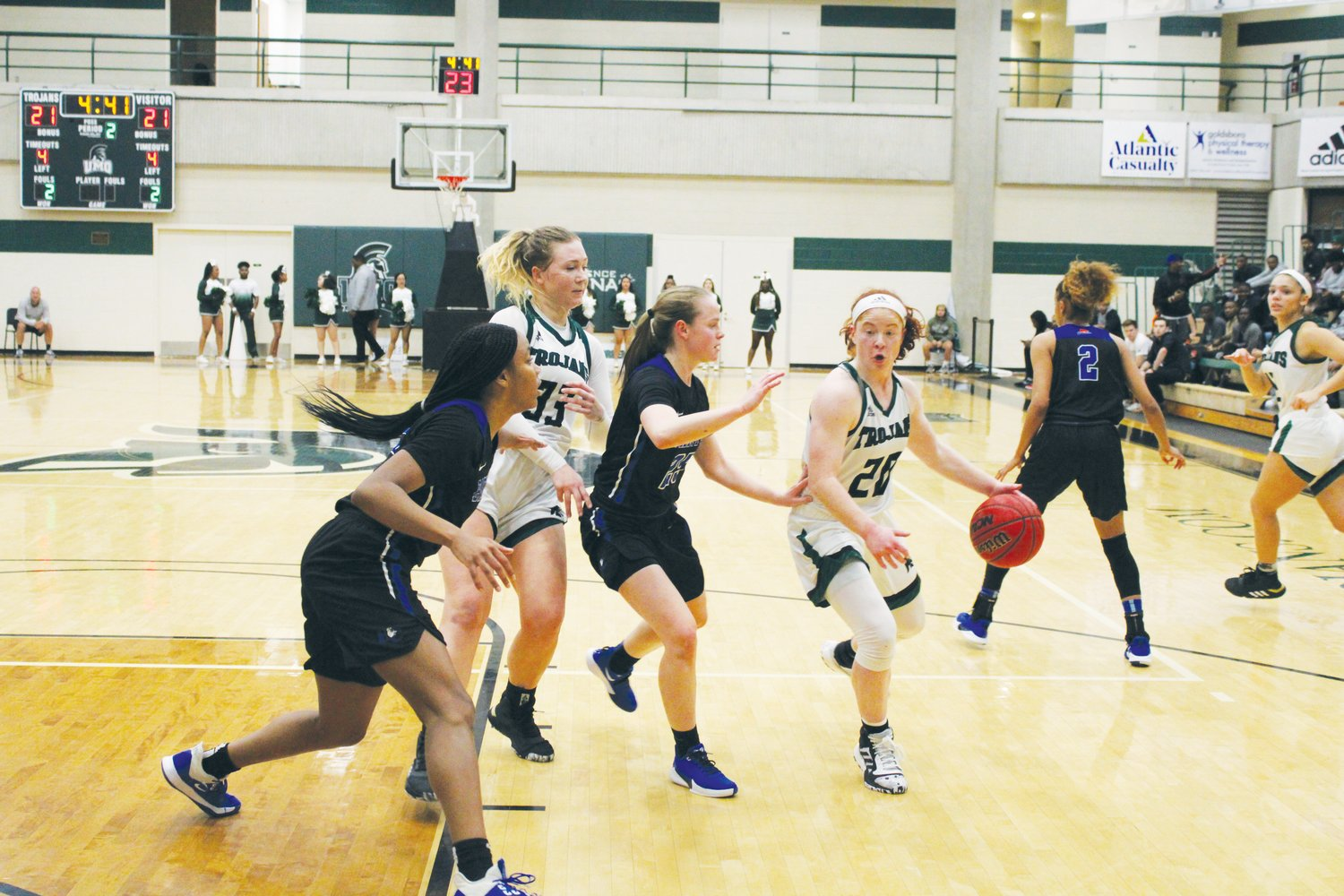 University of Mount Olive point guard Kelly Post drives to the basket during a recent home game. The Trojan women remain in position to host an opening-round game in the season-ending Conference Carolinas women's basketball tournament.