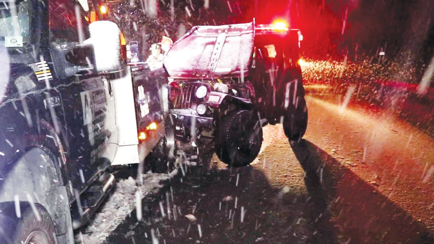 Jeep crashes into wrecker on snowy road....The driver of a wrecker aiding a motorist stuck on an embankment during Thursday's snowy weather got more than he bargained for at the scene. The wrecker, from A+ Towing and Recovery in Mount Olive was in the process of pulling the spun out vehicle onto Interstate 40 when a driver heading west on the interstate, lost control and struck the rear of the tow truck. The driver said when he saw the Jeep headed his way, he ran from the rear of the wrecker, escaping without being hit himself. The wrecker driver said he sustained only minor injuries when running away from the crash. The driver of the Jeep was uninjured.