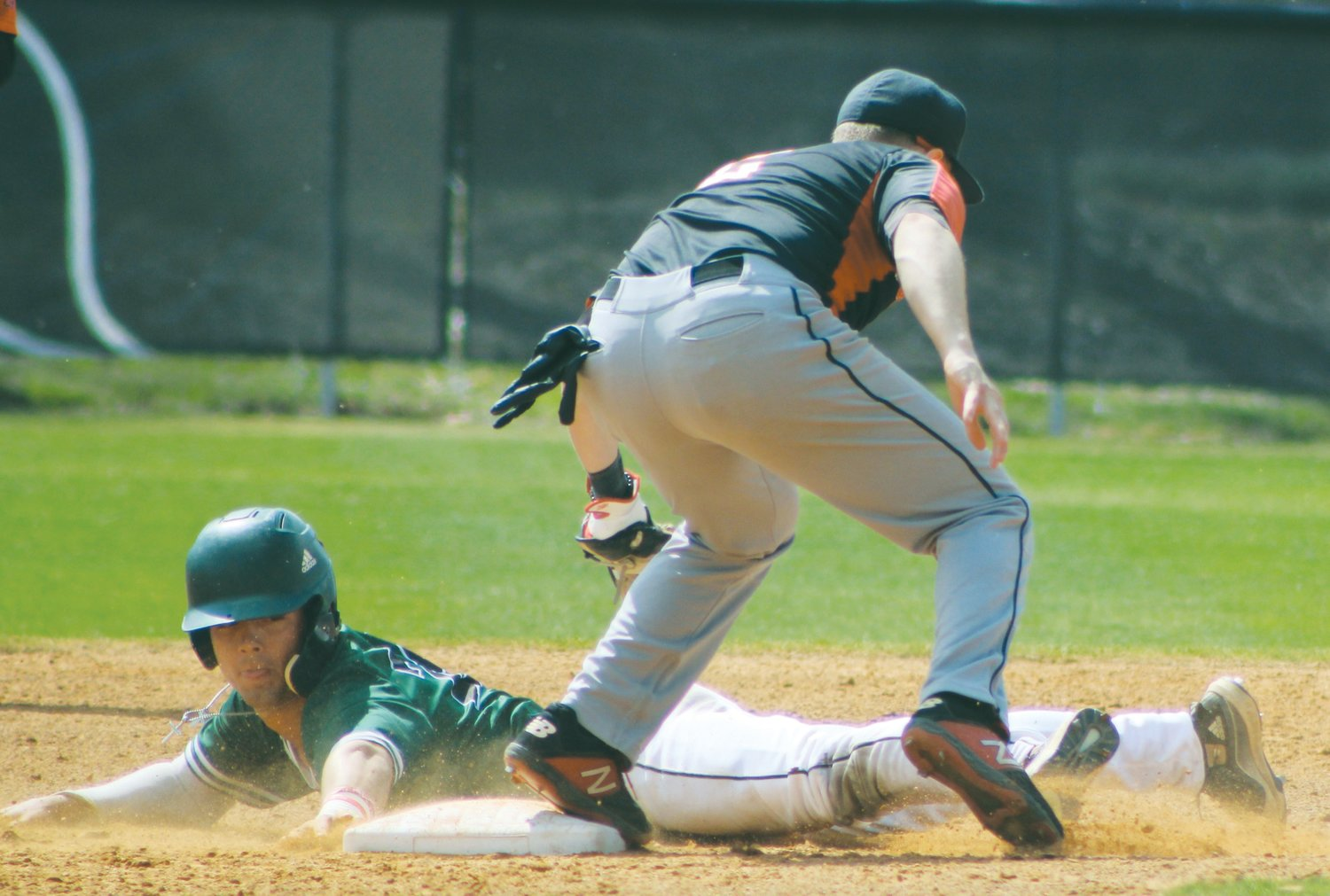 University of Mount Olive's Hunter Gore steals second base during the Trojans' regular-season finale against Dominican (New York) College. The COVID-19 health scare prompted UMO and Conference Carolinas to cancel the remainder of the spring sports season.