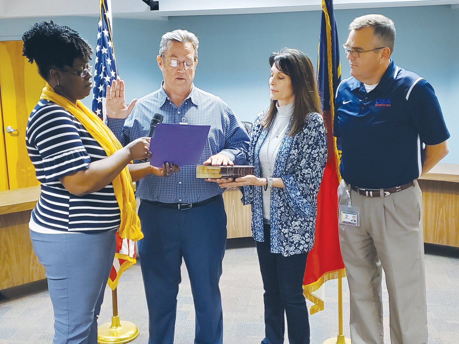 Wade Leatham, second from left, is officially sworn in as the new District 6 representative on the Wayne County Board of Education. With Leatham are BOE Assistant and Notary Public Trish Lateisha Williams, wife Sheila Leatham and Dr. Michael Dunsmore, superintendent of Wayne County Public Schools.