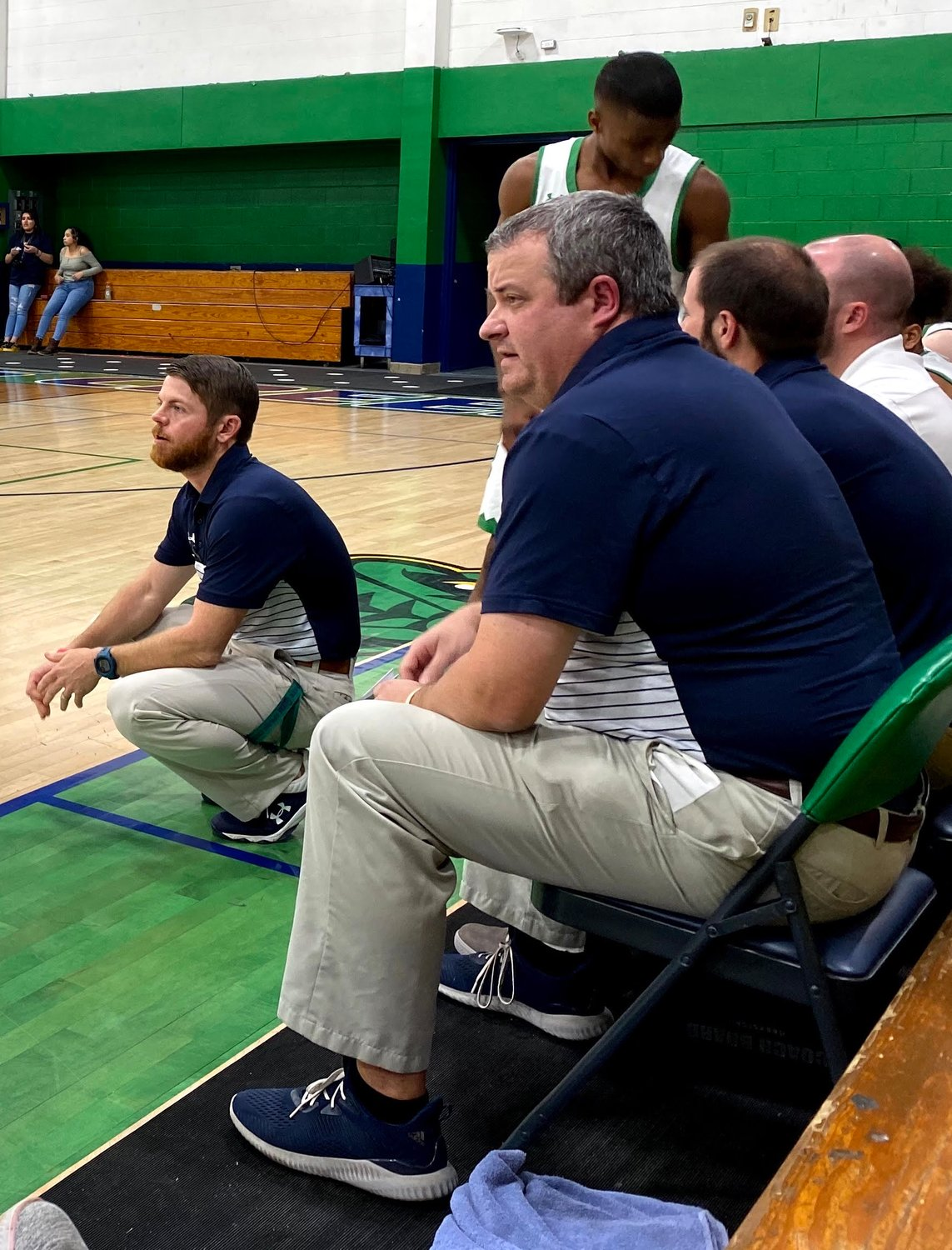 Taylor Jones, squatting, resigned as head varsity boys' basketball coach at Spring Creek. Jones guided the Gators to 135 victories in 12 seasons.
