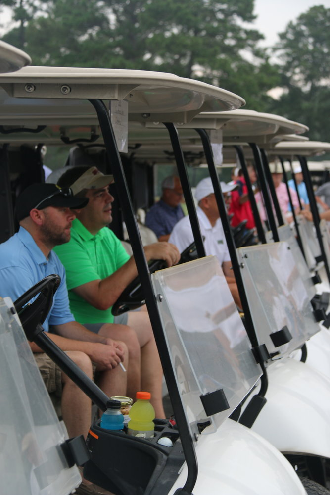 Golfers watch from the gallery during the concluding moments of a recent Michael Martin Memorial Golf Tournament. The 2020 event is scheduled for August 20 at Southern Wayne Country Club.